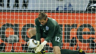 Robert Green of England misjudges the Jabulani ball and lets in a goal during the Group C game against the USA.