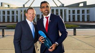 Adam Goodes is congratulated by Tony Abbott.