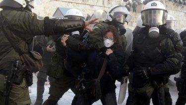 A woman is arrested by riot police during a huge anti-austerity demonstration in Athens' Syntagma (Constitution) square.
