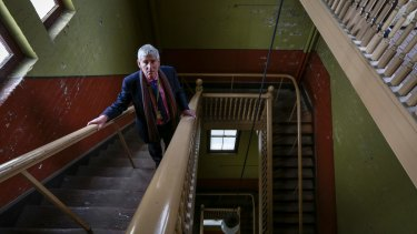 Museum Victoria chief executive Dr Patrick Greene on the stairs leading to the dome.