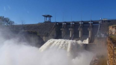 Water surges out of Wivenhoe Dam after recent heavy rain.