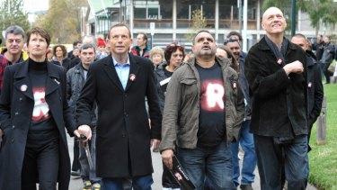 United: Margaret Abbott, Coalition leader Tony Abbott, Michael Long and Schools Minister Peter Garrett on Sunday.