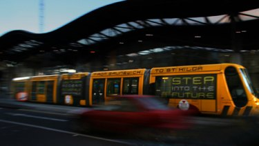 Flight of the Bumblebee: One of the new No. 96 trams passes Southern Cross Station. PICTURE: JUSTIN McMANUS