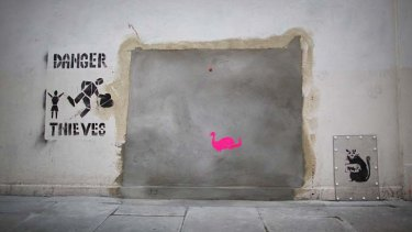 """Stolen? ... a new stenciled rat and """"Danger Thieves"""" appears where the old Banksy artwork was removed."""