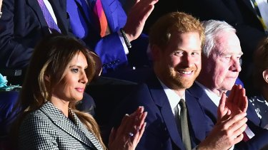 US first lady Melania Trump, Prince Harry and Canada's Governor General David Johnston at the opening ceremony of the Invictus Games.
