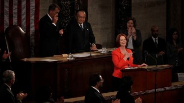 The Speaker of the House John Boehner wipes away a tear  as Australia Prime Minister Julia Gillard places her hand on her heart during a standing ovation following her address to a Joint Meeting of Congress in Washington DC.