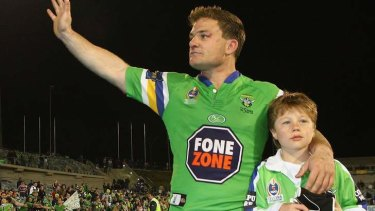 Simon Woolford of the Raiders farewells the Canberra crowd with his son Zac, in 2006.