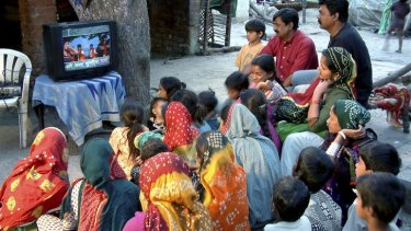 Viallagers in Gujarat watch subtitled Bollywood films.