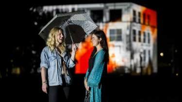 Emma Wild (28) and Hannah Purdy (25) in front of the questacon building on Saturday night at Enlighten.