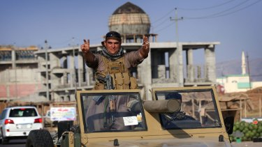 Confident: Iraqi Kurdish fighters take on the Islamic State.