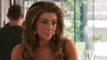 Gina reacts to news that the other women have been gossiping about her.
