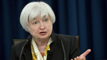 Janet Yellen after the Fed's open market committee meeting on Wednesday. The central bank left the target range for the benchmark federal funds rate unchanged.