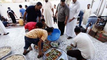 In limbo ... Janzour residents prepare food for Libyan rebels last week.