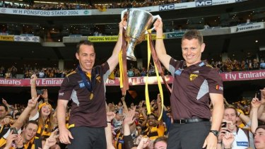 Alastair Clarkson (left) and assistant Brendon Bolton.