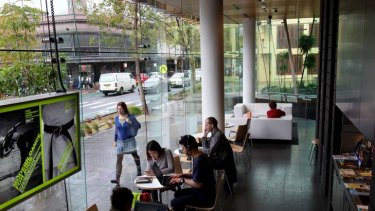 Welcoming ... light and and airy spaces draw a constant flow of patrons to Surry Hills library.