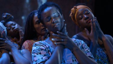 Aminata Conteh-Biger (centre) in the play, which focuses on the lives of a group of African refugees and their struggles with sexual and physical violence before arriving in Sydney.