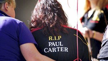 Family and friends of Paul Carter rally outside the Mildura courthouse yesterday.