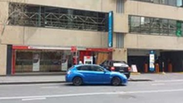 The Porsche was used to crash into the bank, while the blue Subaru WRX was used as the getaway car.