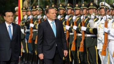 Prime Minister Tony Abbott and Chinese Premier Li Keqiang in Sanya, China.