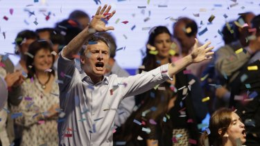 Presidential candidate Mauricio Macri dances  after speaking to supporters in October.