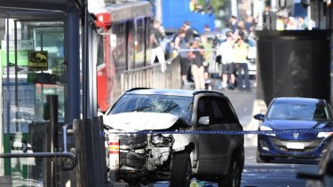 The damaged vehicle after it ploughed through a crowded intersection and then smashed into a tram stop.
