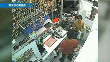A still taken from security cameras inside a convenience store show a man resembling Roberto Laudisio Curti shortly before his death.