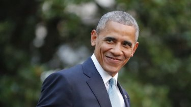 President Barack Obama smiles as he walks across the South Lawn of the White House.