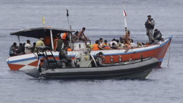 A boatload of asylum seekers are processed by Australian Customs and Dept of Immigration staff at Flying Fish Cove, Christmas Island.