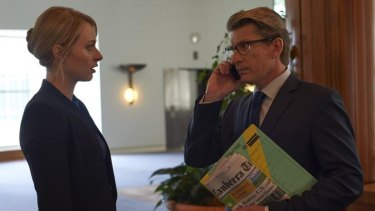 Chelsie Preston Crayford as media adviser Sophie Walsh with David Wenham as Deputy Prime Minister Ian Bradley in the ABC TV political thriller The Code, which was shot in Parliament House.