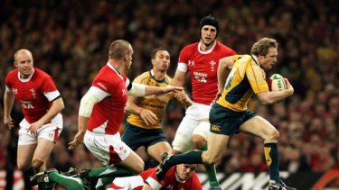 Hynes legs . . . Wallabies winger Peter Hynes bolts through the Welsh defence to set up another attack in the tour-ending victory at Millennium Stadium on Saturday.