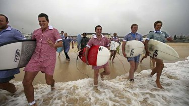 Surfers who are raising money for charity, from left to right, Si Muddell, Nic Claase, Greg Beazley and Will Bigelow at Bondi Beach.