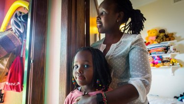 """Kenyan migrant and mother Chebiwot Kipsaina and her Australian born daughter Malaika Kisia.  """"I wanted a school that went beyond that,"""" says Chebiwot."""