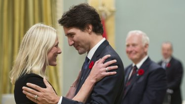Canadian Prime Minister Justin Trudeau hugs Environment and Climate Change Minister Catherine McKenna.