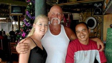 Australian man Greg Cummins (middle) and his daughter, Ellie (left).