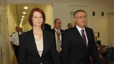 Julia Gillard and Wayne Swan enter today's Labor caucus meeting.