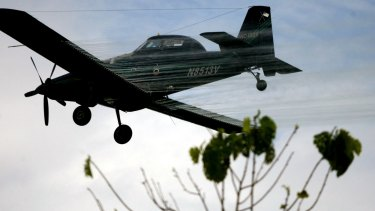 A plane sprays coca fields with weedkiller in Colombia in 2006 to eliminate plants that are the source of cocaine.