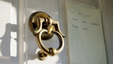 A note on the door of Breyer's home in 2012. <i>Photo: AP</i>