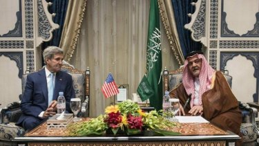 Uneasy allegiance: US Secretary of State John Kerry talks business with Saudi Foreign Minister Prince Saud al-Faisal in Jeddah, Saudi Arabia, on Thursday, September 11.