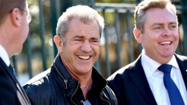 Shooting in Sydney: Mel Gibson with Deputy Premier and Arts Minister Troy Grant (left) and Industry, Resources and Energy Minister Anthony Roberts at the Fox Studios announcement.