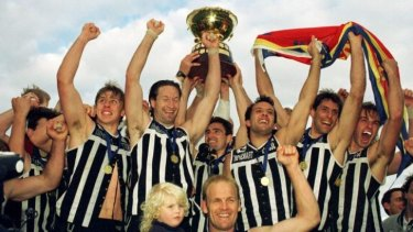 The Port Adelaide Magpies celebrate their 1996 SANFL premiership win