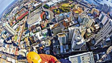 """""""Industrial abseiler'' ... Daniel Keyte at work. The Herald photographer Nick Moir saw him and persuaded him to take a snap of himself."""