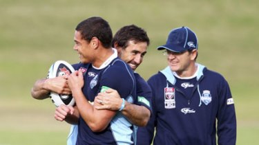 Claims that it improves strength ... Timana Tahu and Andrew Johns wear the Power Balance wrist bands.
