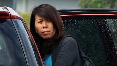 Questions raised … migration agent Xu Xu Li outside her Lidcombe home.