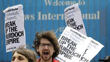 Protesters shout their opposition to the News of the World outside News International's headquarters in London.