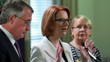 Prime Minister Julia Gillard, Treasurer  Wayne Swan and Disabilities Reform Minister Jenny Macklin announce a Medicare levy raise to fund an NDIS