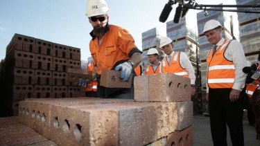 Coalition leader Tony Abbott tours a brickworks in Longford, Tasmania, on Tuesday.