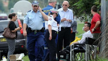 Roger Dean, seated, is given oxygen after the fire engulfed the Quakers Hill nursing home.