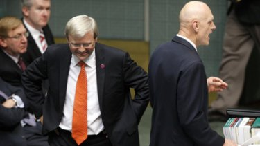 The buck stops here ...  the Prime Minister listens to Peter Garrett during question time yesterday.