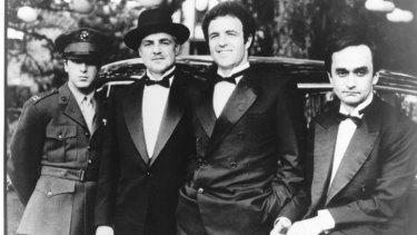 Micheal (Pacino), Don Vito Corleone (Marlon Brando), Sonny (James Caan) and Fredo (John Cazale) in <i>The Godfather</i>.