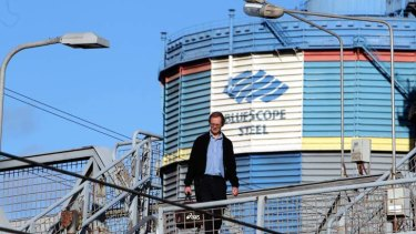 A Bluescope Steelwork employee leaves his day shift near Cringila station after the news that 800 jobs will be cut.